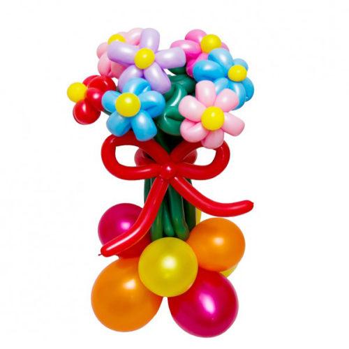 Букет из 7 разноцветных цветов на основании бантом