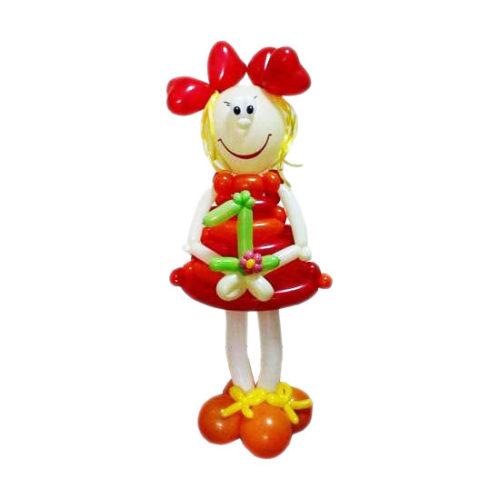 Девочка в красном платье и туфельках из воздушных шаров