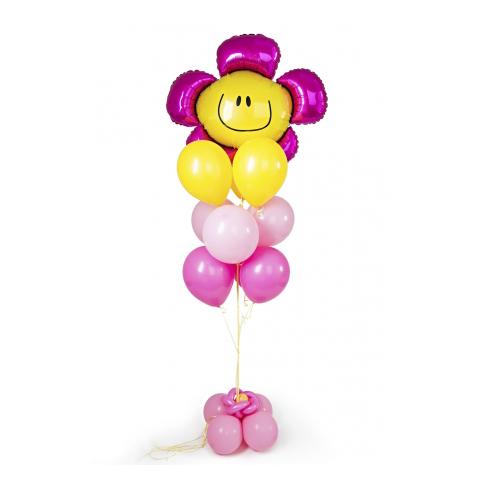 Фонтан с цветочком и желтыми и розовыми воздушными шарами