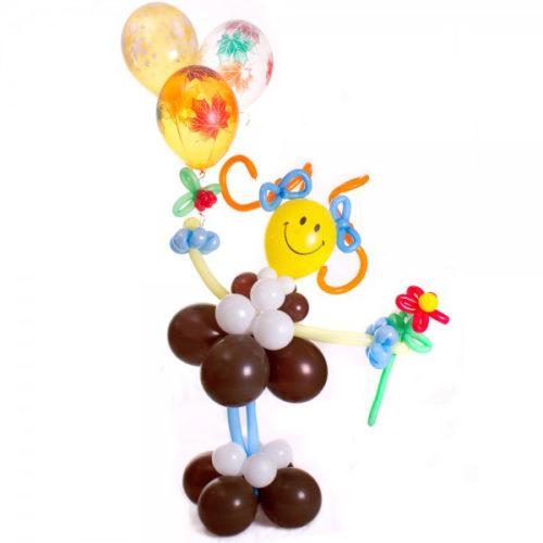 Школьница с цветком из воздушных шаров