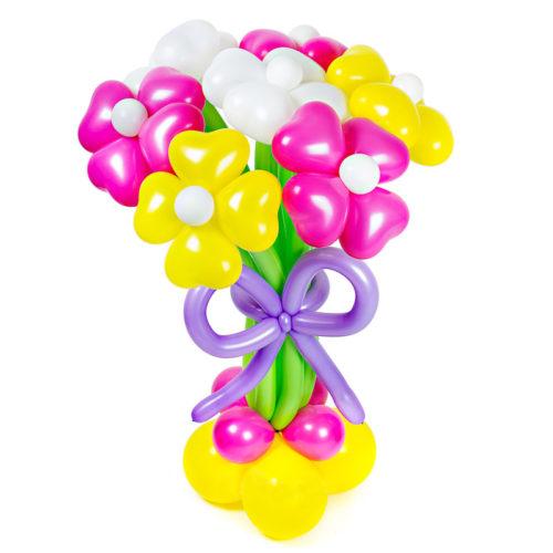 Экибана из 7 цветочков на стойке из воздушных шаров